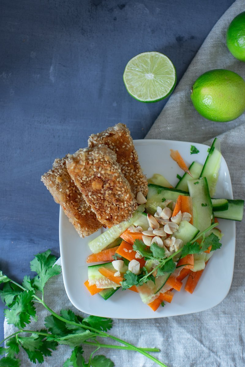 Easy and healthy recipe for a crispy sesame tofu with carrot cucumber salad