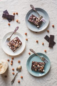 Simple Brownie recipe for homemade brownies from scratch. Eggless, easy to make and vegan - this is the best recipe for moisture brownies. Topped with hazelnuts, peanut butter and chocolate, this aesthetic sweet dessert is not only a treat for your soul, but also a feast for the eyes. #chocolate #easyrecipes #vegandessertrecipes #baking #recipe #brownies #homemadebrownies