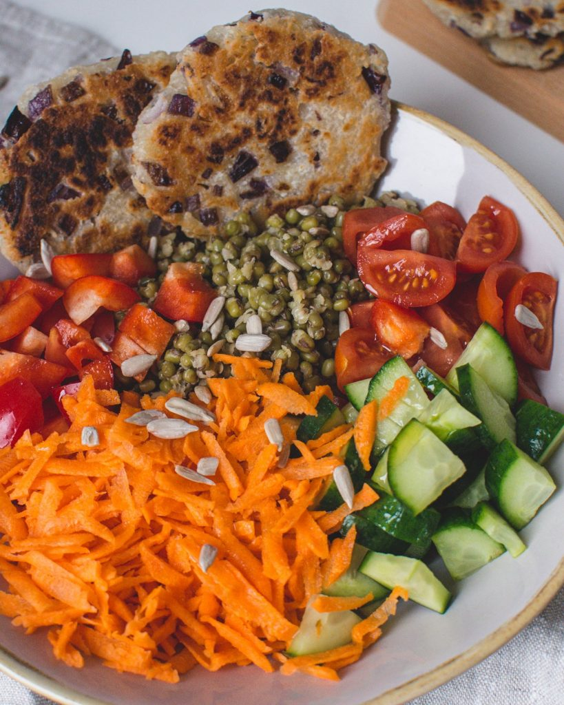 This Salad bowl is pure perfection: Protein-rich mung beans, filling roti, and fresh healthy salad. This bowl is perfect for lunch, dinner, and even for meal prep.